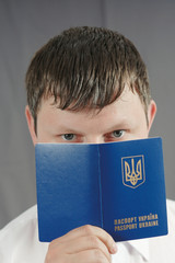 man holding Ukrainian passport
