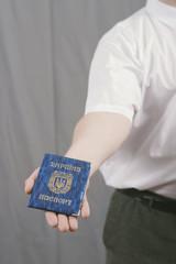 hand holding Ukrainian passport
