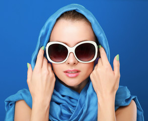 Portrait of an attractive young woman in sunglasses. Retro