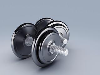 Two black dumbbells for fitness