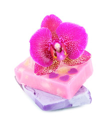 Soap and orchid isolated on white