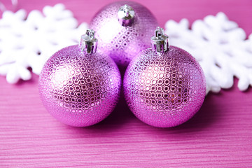 Christmas balls on purple background