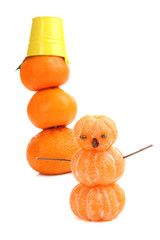 Snowmen, prepared with tangerines, isolated on white