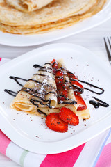Delicious pancake with strawberries and chocolate