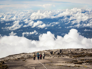 Unrecognizable Hikers at the Top of Mount Kinabalu, Malaysia