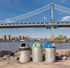 Recycle bins with the Manhattan Bridge Background