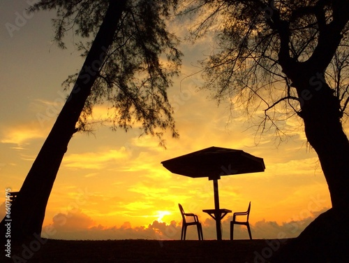 restaurant table on beach at sunrise