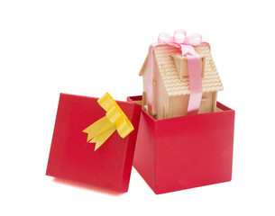 house wrapped with ribbon in a present box with clipping path
