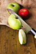 Kitchen knife and green apple,   on wooden background