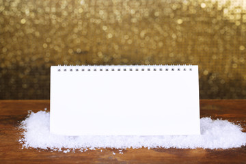 Empty calendar on shiny golden background