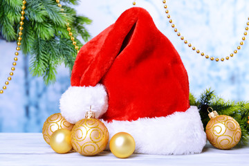 Composition with Santa Claus red hat and Christmas decorations