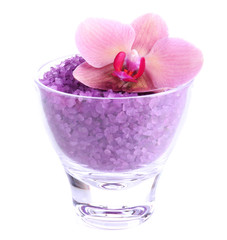 Color sea salt in glass bowl and  orchid flower, isolated