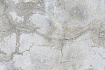 Old grunge crack grey concrete wall texture background.