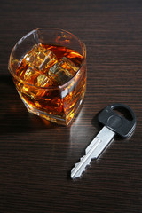 Composition with car key and glass of whiskey,