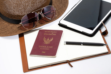 sunglasses with notebook and passport isolated on white