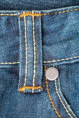 belt loops on blue jeans
