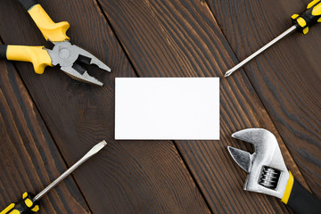 blank card and tools on wood