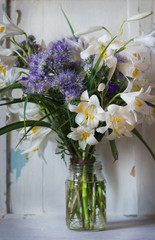 romantic bouquet of white lilies and blue flowers