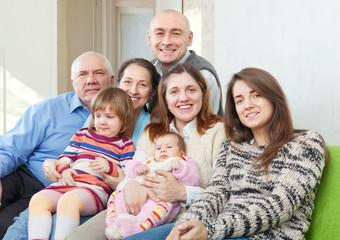 joyful grandparents with  children and grandchildren