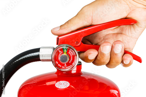 Leinwanddruck Bild Holding fire extinguisher isolated , with clipping path