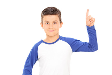 Boy pointing up with a finger