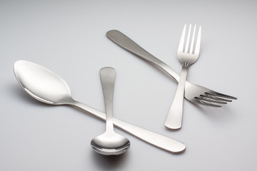 silver fork with spoon isolated on gray background