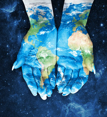 Map painted on hands.Concept of having the world in our hands in