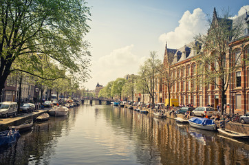 Beautiful view of Amsterdam canals with bridge and typical dutch