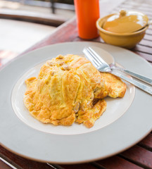 Food, omelet on rice on a wood table