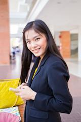 Beautiful young Asian businesswomen using a smart phone