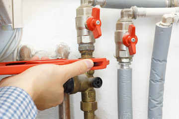 plumber fixing pipe system