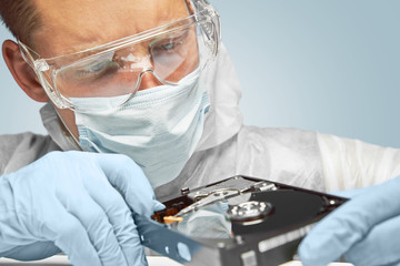 Technician examines the hard disk