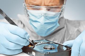 Technician repairs the hard disk