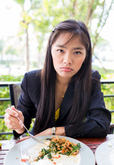 Asian young businessmanwomen Are eating breakfast