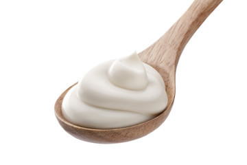 cream in spoon isolated