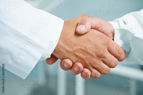 Man doctor shakes hand
