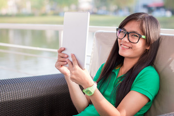 Pretty Asian female adolescents use technology for communication