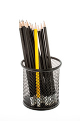 black pencil holder with pencils isolated on white background