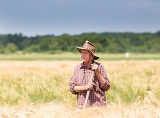 Worker in barley field
