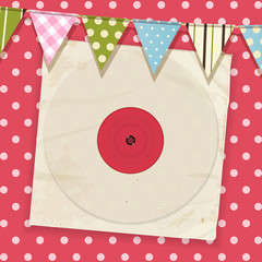 vintage record and sleeve with bunting on a pink polka dot backg