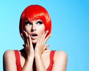 Surprised face of an young pretty woman with red hairs