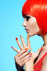 Profile portrait  of a fashion model with  red hairs and multico