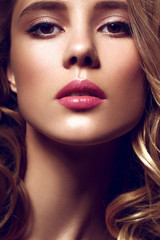 Beautiful young model with pink lips. Make up.
