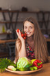beautiful smiling girl holding vegetables in her hands