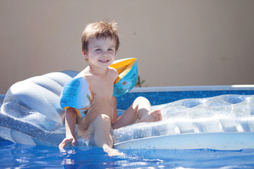 Cute kid in a big swimming pool