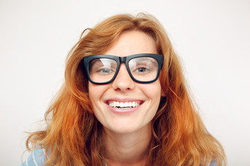 Portrait of happy funny young woman with black glasses.