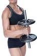Female strong bodybuilder holding large black dumbbell