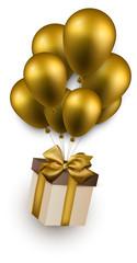 Gift box on golden balloons.