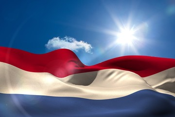 Dutch national flag under sunny sky