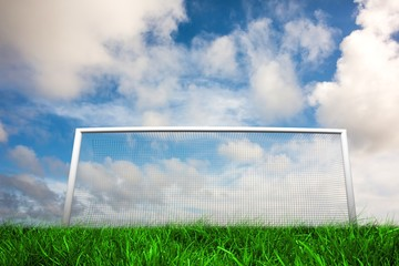 Football goal under blue cloudy sky